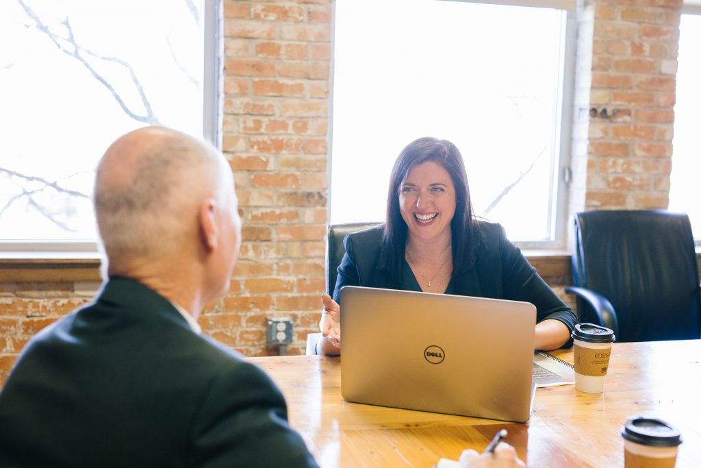 Woman interviewing older man - Octopus Personnel Age-Positive Work Culture