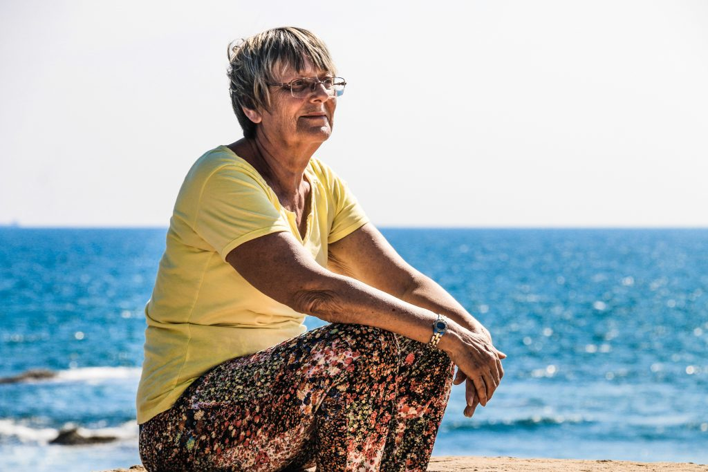 Woman sitting on the beach - Octopus Personnel Age-Positive Work Culture