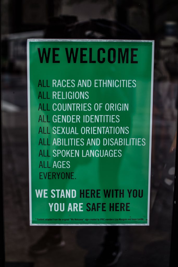 A poster showing all people are welcome - Octopus Personnel Speak Out against Racism and Discrimination in the Workplace