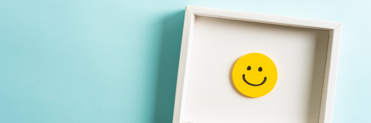 Image of a smiling face icon in a frame - Recognition matters - Mental Health Awareness at Work