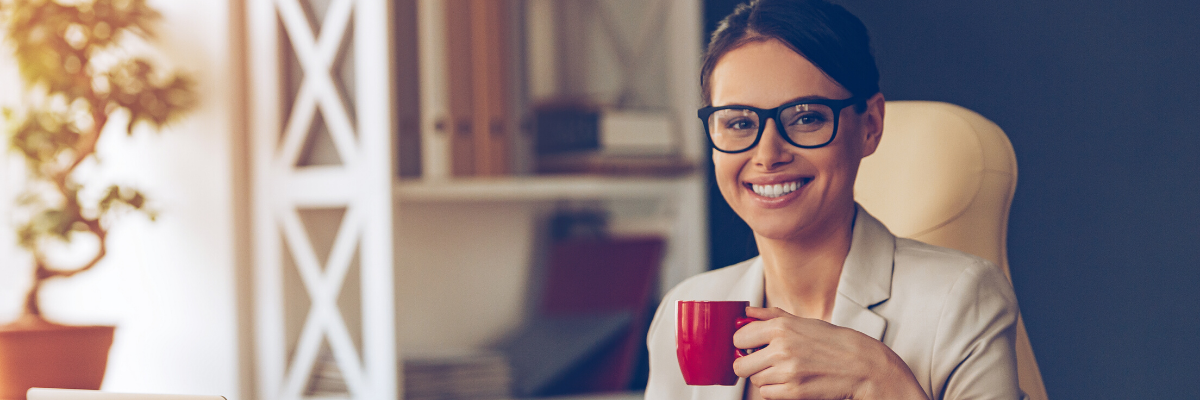 Woman drinking coffee at a laptop - Write a clear and concise profile to hook employers in - Targeting your CV for success in 2020