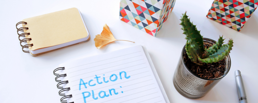 Notebook with action plan written in: Manage uncertainty by taking small steps